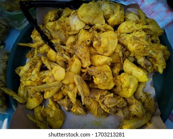 ayam ungkep is processed chicken meat by boiling it first using herbs and spices.  can be fried immediately or burned and then eaten