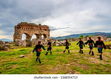 Aydin, Turkey - April 13, 2019 : Turkish Efe's are dancing in Tralleis Ancient City, Aydin
