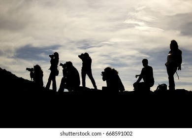 Aydin, Turkey - March 2016: Silhouette of photographers on the mountain. They are taking photos.