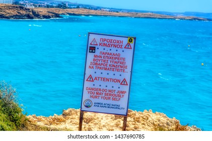 AYIA NAPA, CYPRUS, July 19 2017: Warning sign at dangerous cliff near Nissi Beach in Ayia Napa, Cyprus.