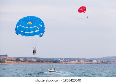 Ayia Napa, Cyprus - June 16, 2018: Parasailing Boat at Agia Napa bay, tourists fly parachute