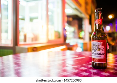 AYIA NAPA, CYPRUS,- SEPT.19,2013: Budweiser beer bottle empty on a table outside a bar in ayia napa, cyprus.Budweiser is an American-style pale lager produced by Anheuser-Busch