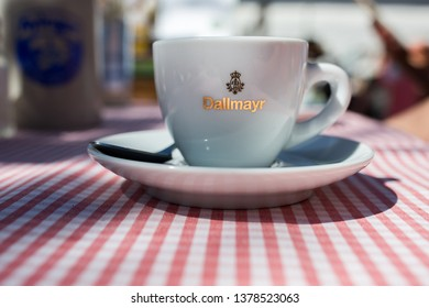 "AYING, BAVARIA / GERMANY - April 21, 2019: Side view on a cup with ""Dallmayr"" writing. The company Dallmayr has an over 300-year history, the headquarter is located in Munich."