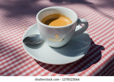 "AYING, BAVARIA / GERMANY - April 21, 2019: Close up of a espresso cup with the writing ""Dallmayr"". Dallmayr is the largest delicatessen business in Europe and a well-known German coffee brand."