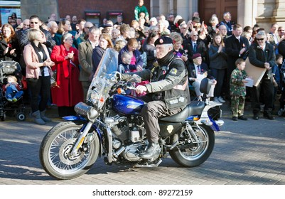 AYLESBURY, ENGLAND - NOVEMBER 13: A military veteran of the Royal British Legion attends the Armistice Day ceremony on his motorcycle as part of the military parade on November 13, 2011 in Aylesbury