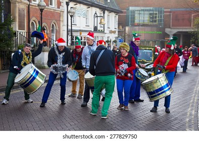 AYLESBURY, UK - NOVEMBER 30: A local street band leads the Aylesbury Christmas parade through the market square alongside other acts as part of the Christmas parade on November 30, 2014 in Aylesbury