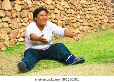 Aymara woman showing welcoming gesture