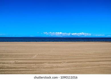 Ayr beach and the Isle of Arran on a summer day