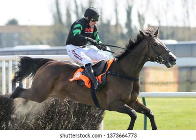 AYR RACECOURSE, AYRSHIRE, SCOTLAND, UK : 13 APRIL 2019 : Molly The Dolly ridden by jockey Harry Skelton Winning the Novices Champion Handicap Chase at Ayr Races