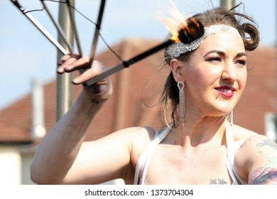 AYR RACECOURSE, AYRSHIRE, SCOTLAND, UK : 12 APRIL 2019 : A Fire Eater performs outside the racecourse and entertains the crowds before the Scottish Grand National Meeting at Ayr Racecourse