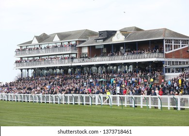 AYR RACECOURSE, AYRSHIRE, SCOTLAND, UK : 12 APRIL 2019 : The crowd in the packed Grandstand at Ayr Racecourse