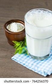 Ayran drink in a glass with yogurt in the background