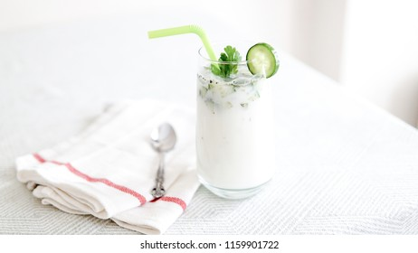 ayran with mint on white background
