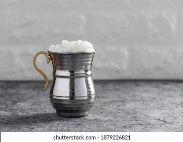 AYRAN. Traditional Turkish yoghurt drink with foam in silver metal cup. Buttermilk.