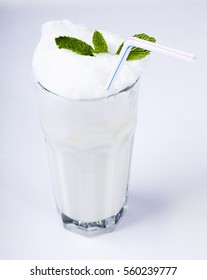 Ayran - Traditional Turkish yogurt drink with mint leaves isolated on white