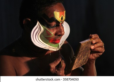 AYROOR, INDIA - JAN 05: An unidentified Kathakali artist does make-up before on-stage performance during a festival organised by District Kathakali club on January 05, 2016 in Ayroor, Kerala,India.