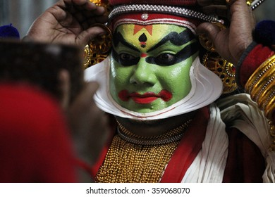AYROOR, INDIA - JAN 05: An unidentified Kathakali artist does make-up before on-stage performance during a festival organised by District Kathakali club on January 05, 2016 in Ayroor, Kerala,India