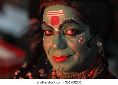 AYROOR, INDIA - JAN 11: An unidentified Kathakali artist looks before the on-stage performance during a festival organised by District Kathakali club on January 11, 2015 in Ayroor, Kerala,India.