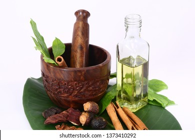 Ayurveda Oil or Ayurvedic Herbs, Oil with Mortar and Pestle