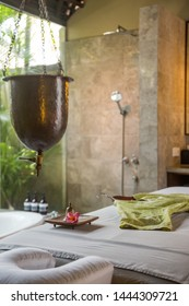 Ayurveda spa treatment copper vessel for shirodhara, oil-dripping treatment setup, no people.