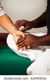 ayurveda treatment with taking pulse diagnostic