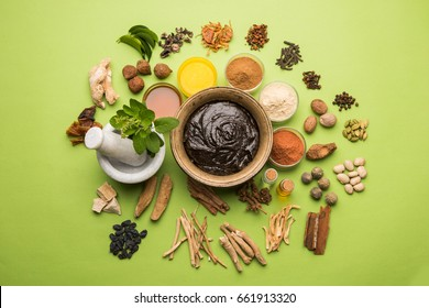 Ayurvedic Chyavanprash or Chyawanprash is a Powerful  Immunity Booster OR Natural Health Supplement. Served in an Antique bowl with Ingredients, over moody background, selective focus