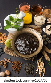 Ayurvedic Chyawanprash is a Powerful  Immunity Booster OR Natural Health Supplement. Served in an Antique bowl with Ingredients, over moody background, selective focus