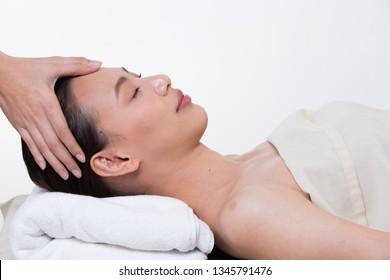Ayurvedic Head Massage Therapy on facial forehead Master Chakra Point of Asian woman, Therapist Spa body woman hands treatment on customer to increase circulation release tension stress, isolated