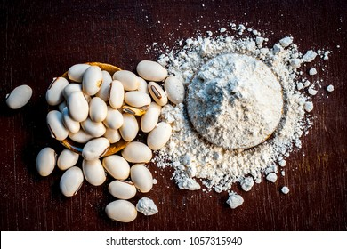 Ayurvedic herb kuanch,cowhage,Mucuna pruriens with powder in a brown plate with its powder and raw kuanch for premature ejaculation, erectile dysfunction and other sperm related diseases.