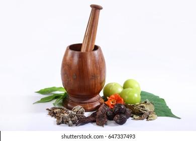 Ayurvedic Oil in Glass Bottle or Herbal Hair Oil with Herbs in
