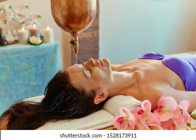 Ayurvedic Shirodhara procedure. Indian massage on the ancient technique of Shirodhara. The best of Indian massage