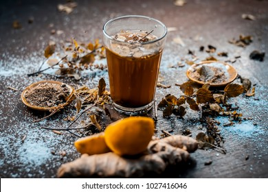 Ayurvedic/Herbal drink i.e Kashmiri Kahwa drunk in winter season in asia and India with all its ingredients in dark Gothic colors.
