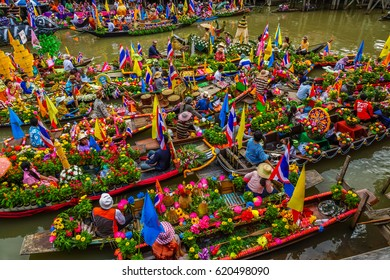 AYUTHAYA, THAILAND - JULY 11, Buddhists do candle festival parade by boat at Ladchado canal in Ayuthaya, Thailand on July 11, 2014