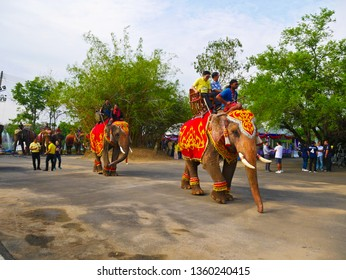 Ayuthaya,Thailand - April 4 2019 : Nonidentical tourist are going to visit Ayuthaya historical Park and ridding elephant for sightseeing at Ayuthaya,Thailand.