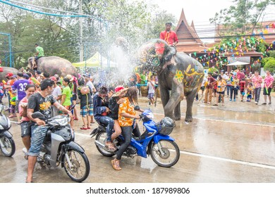 AYUTTAYA, THAILAND - APRIL 14, 2014: Songkran Festival is celebrated in a traditional New Year's Day from April 13 to 15,People enjoy with the splashing water with elephants in Ayuttaya, Thailand.