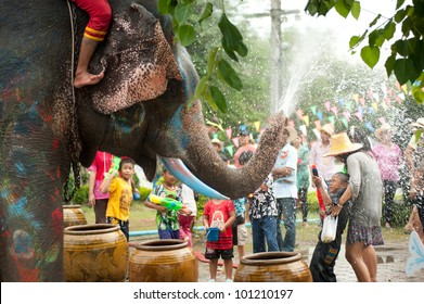 AYUTTAYA, THAILAND - APRIL 14: Songkran Festival is celebrated in a traditional New Year's Day from April 13 to 15, with the splashing water with elephants on April 14, 2012 in Ayuttaya, Thailand.