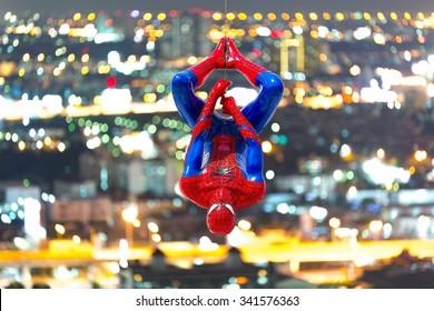 Ayuttaya, Thailand - November 15, 2015 : Spider-Man model upside down on cityscape background.