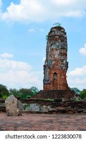 In Ayutthaya, stupa and one of the selmas, stone boundaries delimiting the sacred enclosure of Wat Lokayasutharam, Thailand