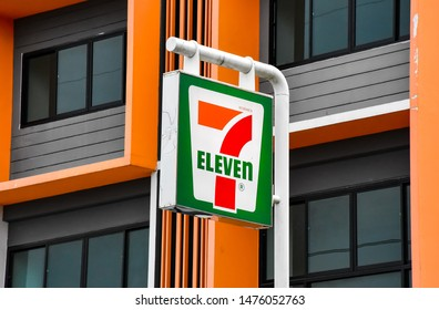 Ayutthaya - Thailand, 11 August 2019: Banner 7-Eleven logo, background is orange building. 7-ELEVEN branch in Thailand. There are 10988 branches. Ranked 2nd in the world.
