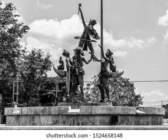 Ayutthaya, Thailand - 12 April 2017: Bronze statue at Pathon Roundabout, depicting three Kinnari (female mythical beings, half-bird and half-woman) holding up a fourth Kinnari with a lotus flower