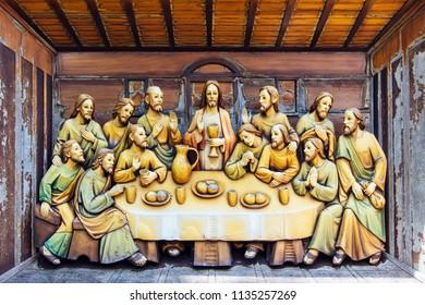 Ayutthaya, Thailand - 23 JUN 2018 : Wood carving of The Last Supper at Saint Joseph Catholic Church, Ayutthaya Thailand.