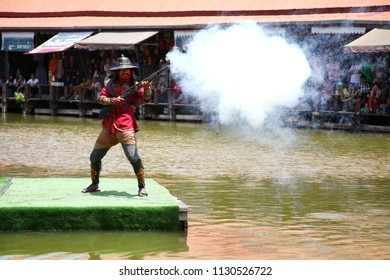 AYUTTHAYA THAILAND –JUN 30 : Thai ancient infantry stunt show at Ayothaya floating market for entertain tourist and local represent Thailand cultural tourism on June 30, 2018 in Ayutthaya ,Thailand.