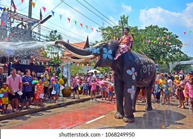 Ayutthaya, Thailand - Apr 13, 2018 : Revelers enjoy water splashing with elephants during Songkran Festival during 13-15 of Apr in Ayutthaya,Thailand. Water splashing is the way Thai people