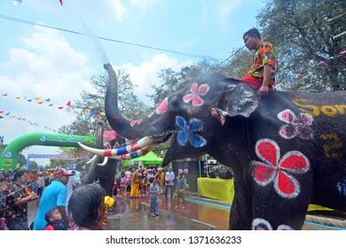 Ayutthaya, Thailand - Apr 13, 2019 : Revelers enjoy water splashing with elephants during Songkran Festival during 13-15 of Apr in Ayutthaya,Thailand. Water splashing is the way Thai people