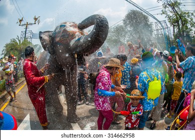 AYUTTHAYA, THAILAND - APR 13: Revelers and elephants join in water splashing during Songkran Festival on Apr 13, 2014 in Ayutthaya, Thailand. The water festival has been observed as Thai New Year.