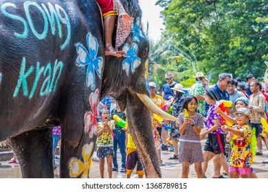 Ayutthaya, Thailand - Apr 14, 2019 : Traveler enjoy water splashing with elephants during Songkran Festival during 13-15 of Apr in Ayutthaya, Thailand, Elephant splashing water Songkran Festiva