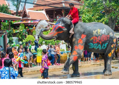 AYUTTHAYA, THAILAND - APR 14:  Revelers enjoy water splashing with elephants during Songkran Festival on Apr 14, 2015 in Ayutthaya,Thailand.  Water splashing is the way Thai people celebrate New Year.