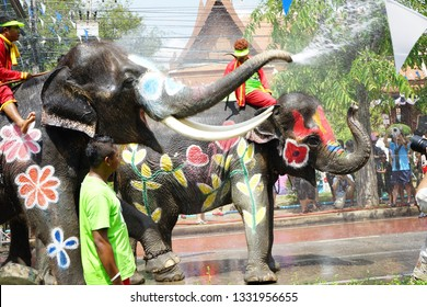 AYUTTHAYA THAILAND - APRIL 13 : Elephant and peples are splashing water in Songkran festival on 13 April 2017 in Ayuthaya Thailand . It's like the New Year's Day