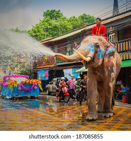 AYUTTHAYA, THAILAND - APRIL 13: Songkran Festival is celebrated in a traditional New Year's Day from April 13 to 15, with the splashing water with elephants on April 13, 2014 in Ayuttaya, Thailand.