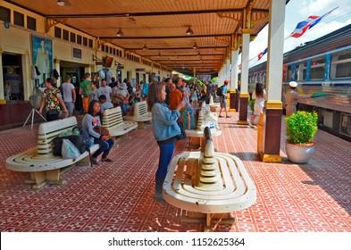 Ayutthaya, Thailand - April 14, 2017: Locals and tourists have just disembarked from the commuter train at Ayutthaya Station.